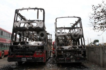1382876149-bangladesh-strike-begins-with-bus-explosion-and-fire-in-dhaka_3066850